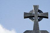 Close up of Celtic cross - grey metal, blue sky