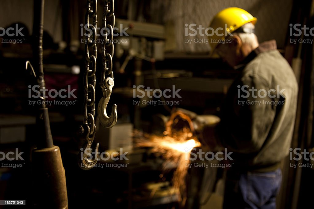 Close up of chains hanging from a hoist in workshop. royalty-free stock photo