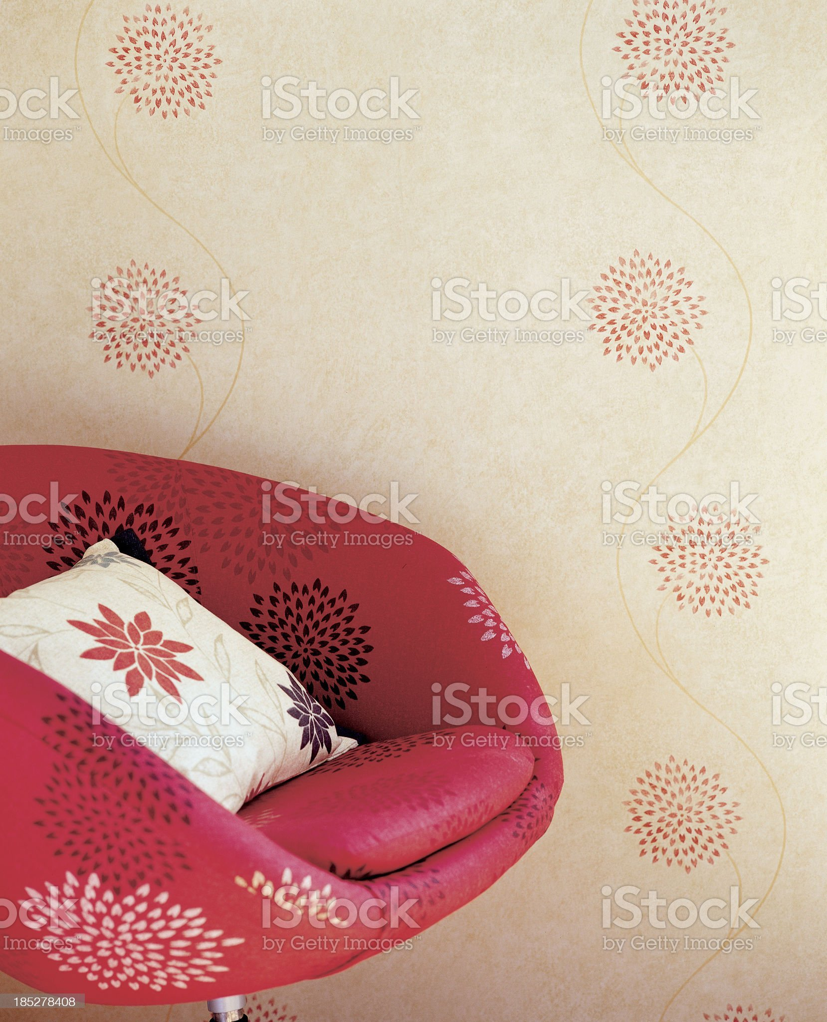 Close up of chair against wallpaper royalty-free stock photo