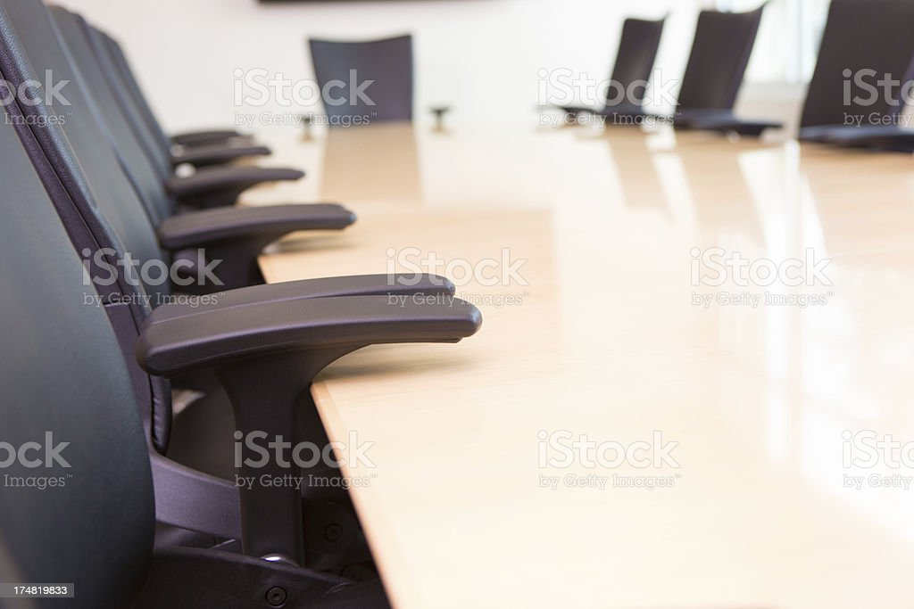 Close up of chairs in company's empty board room royalty-free stock photo