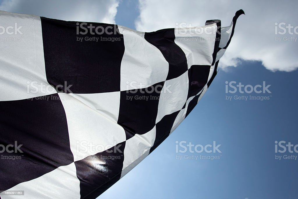 Close up of checkered flag in sky stock photo
