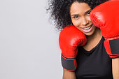 Close up of cheerful woman in fight stand