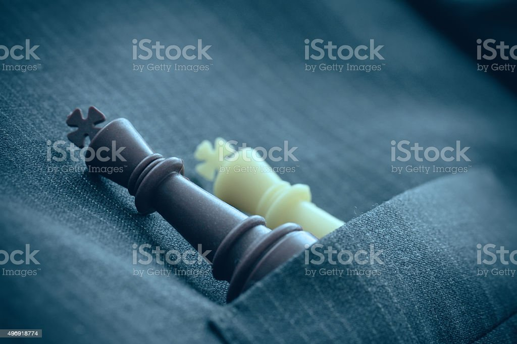 close up of chess figure on suit background strategy stock photo