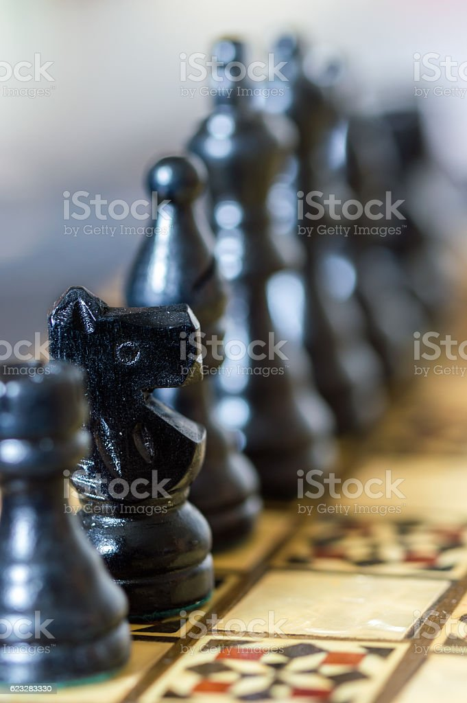 Close up of chess pieces with shallow depth of field. stock photo