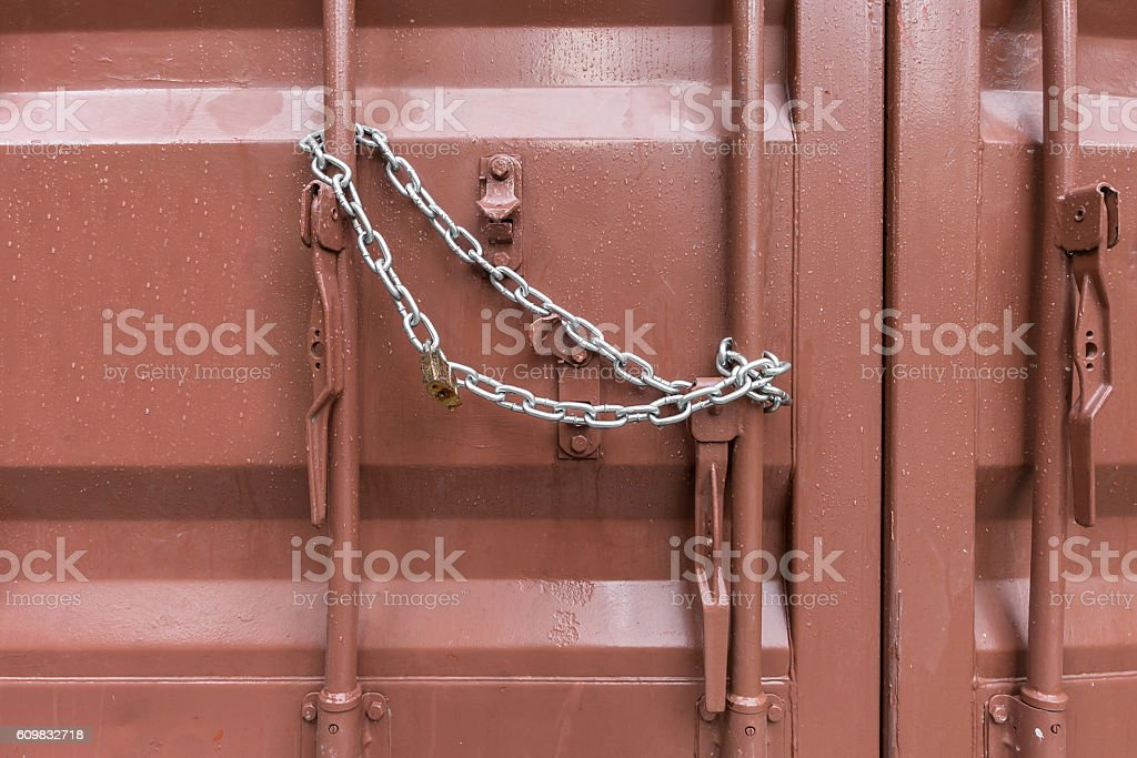 Close up of chestnut container door wet from rain stock photo