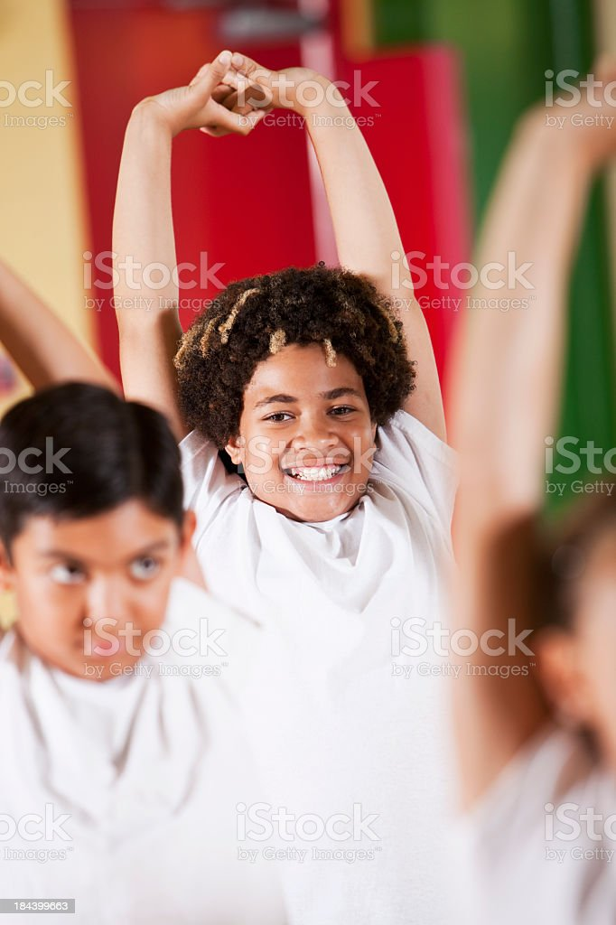 Close up of children stretching stock photo