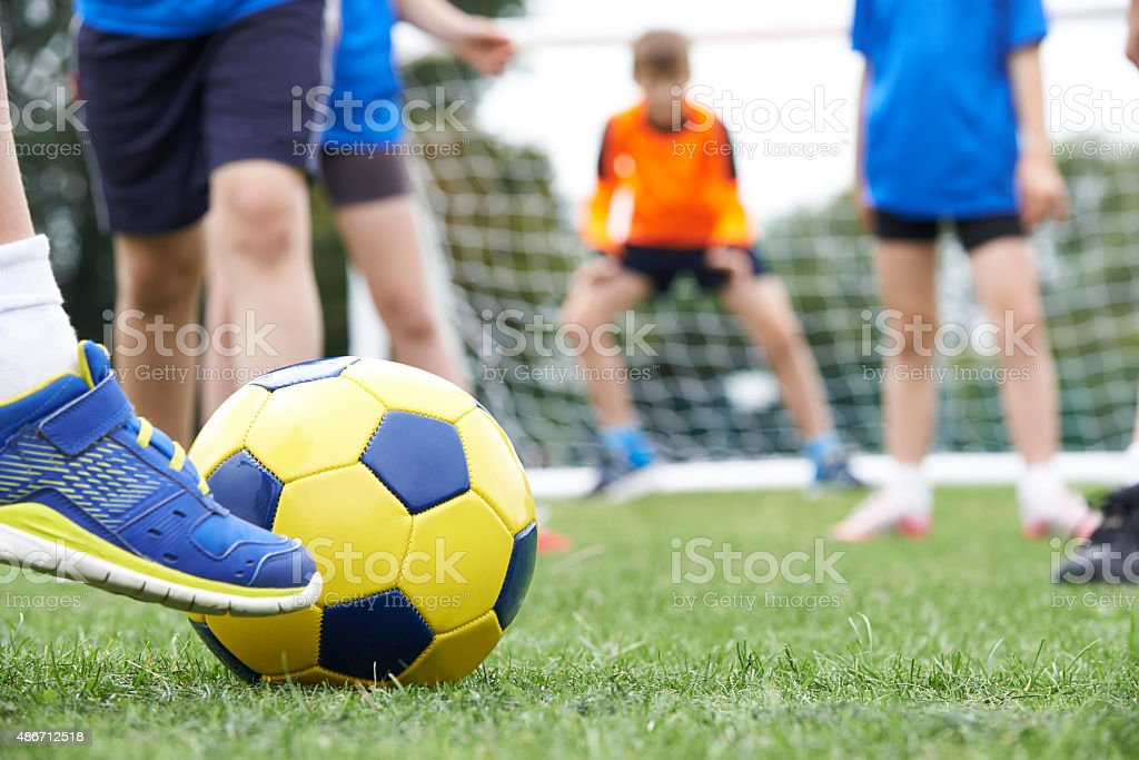 Close Up Of Children's Feet In Soccer Match stock photo