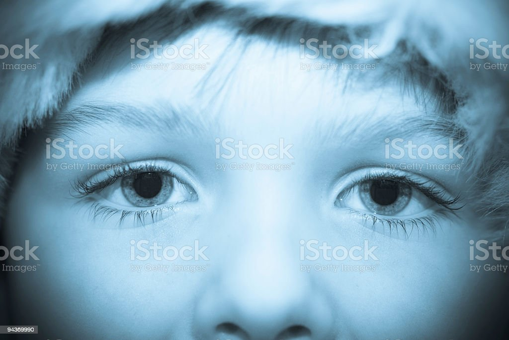 close up of childs blue eyes stock photo