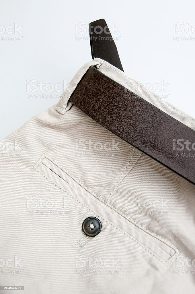 Close up of Chinos with a belt on white background stock photo