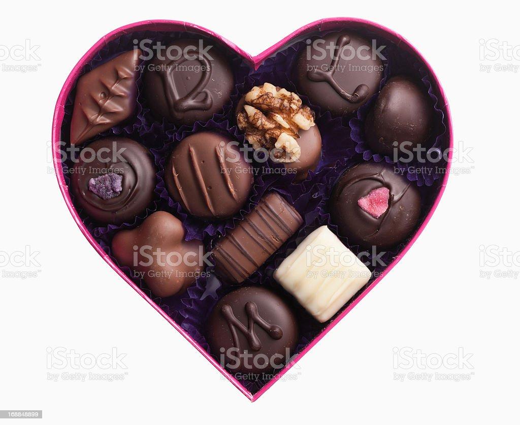 Close up of chocolates in heart-shape box stock photo
