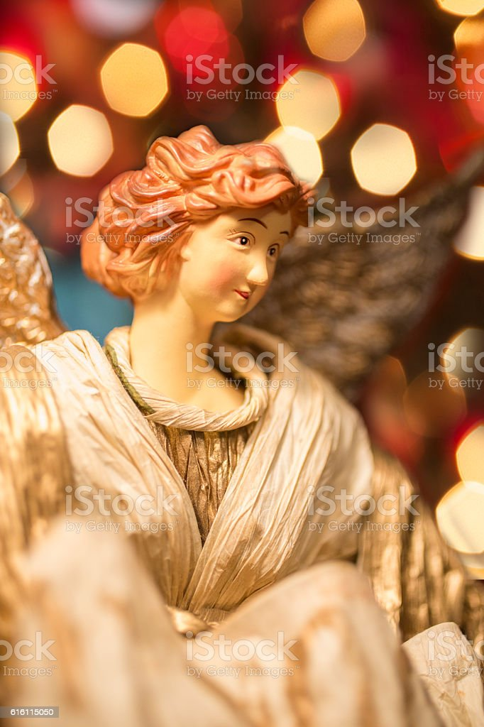 Close up of Christmas angel with holiday lights. stock photo