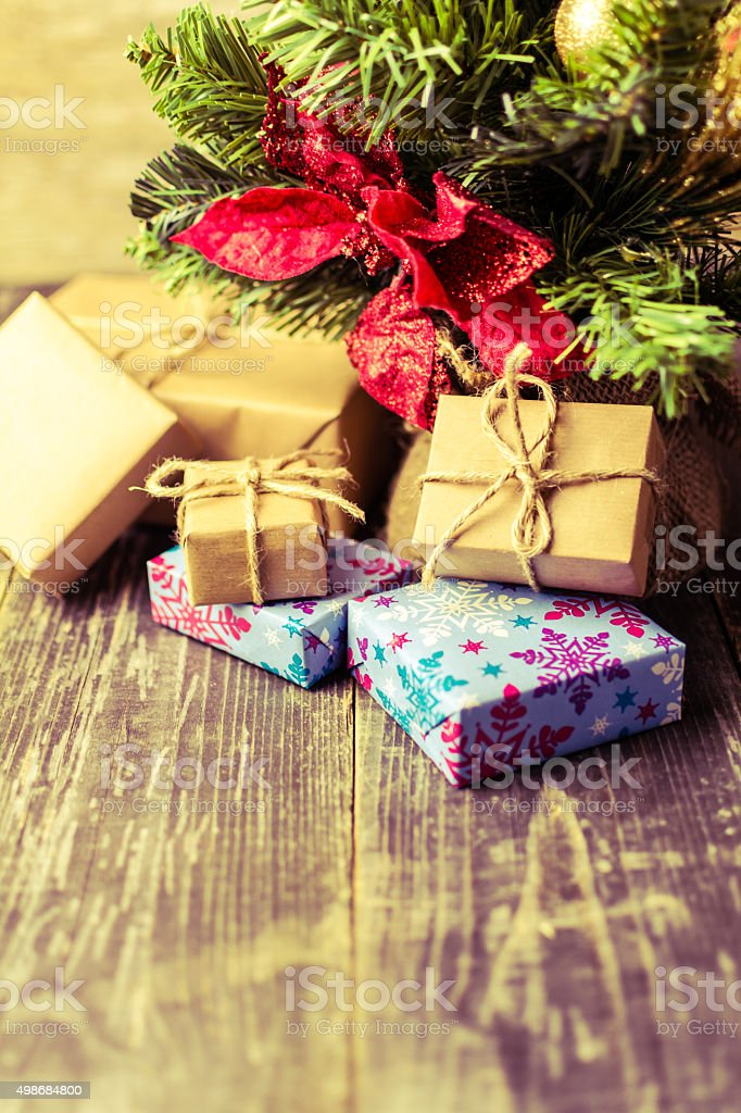 Close Up of Christmas Gifts Under Christmas Tree stock photo