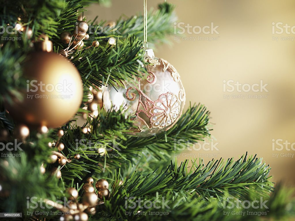 Close up of Christmas ornaments on tree royalty-free stock photo