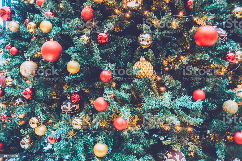 Close Up of Christmas Tree with Red and Gold Baubles stock photo