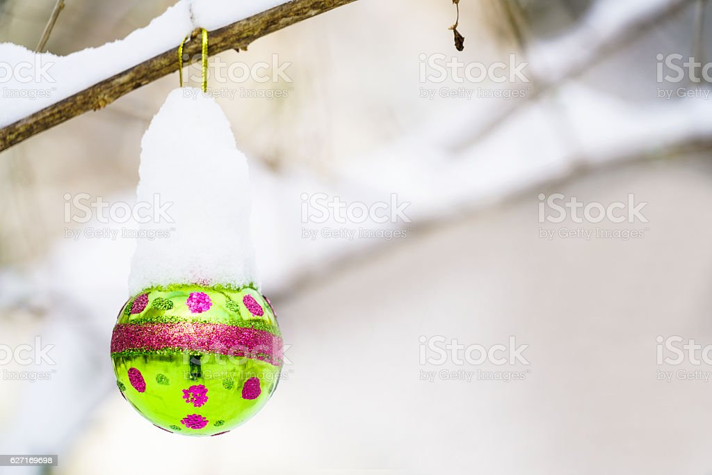Close up of Christmast ball with snow stock photo