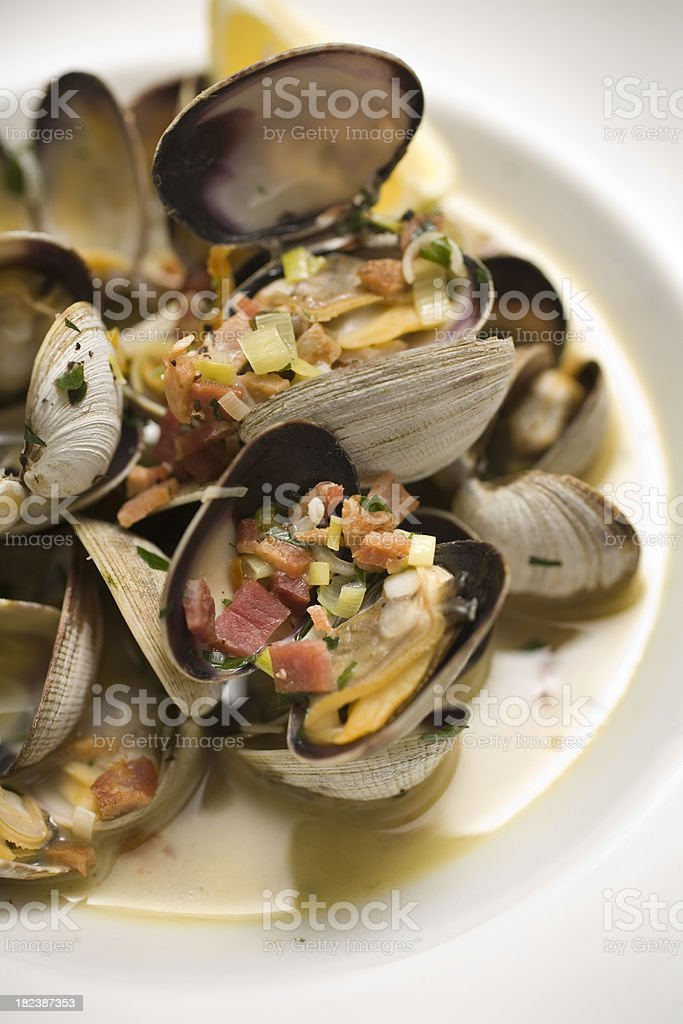 Close up of clams in broth stock photo