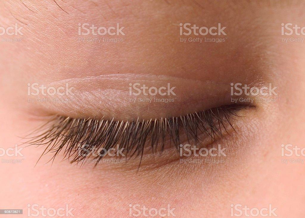 Close up of closed eye with eyelashes stock photo