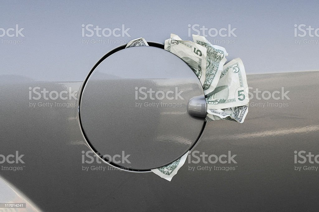 Close up of Closed Gas Tank with Money Sticking Out stock photo