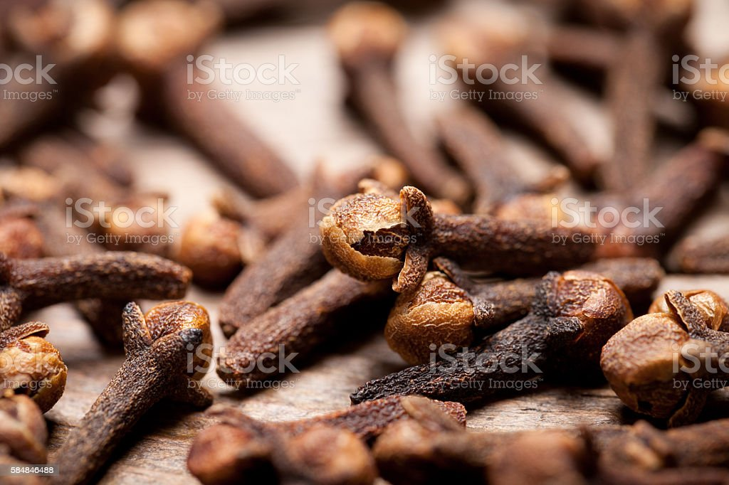 Close up of cloves on old wooden table stock photo