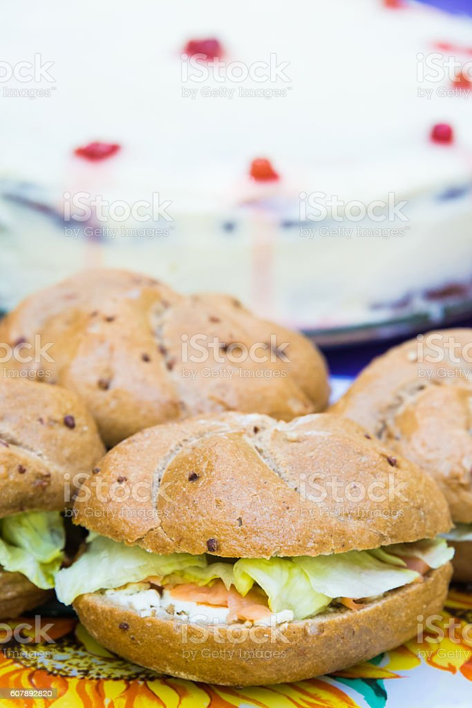 Close up of club salmon sandwiches arranged over a table stock photo