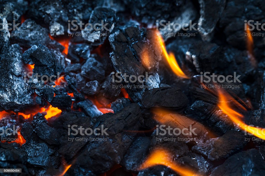 Close up of coal with flame stock photo