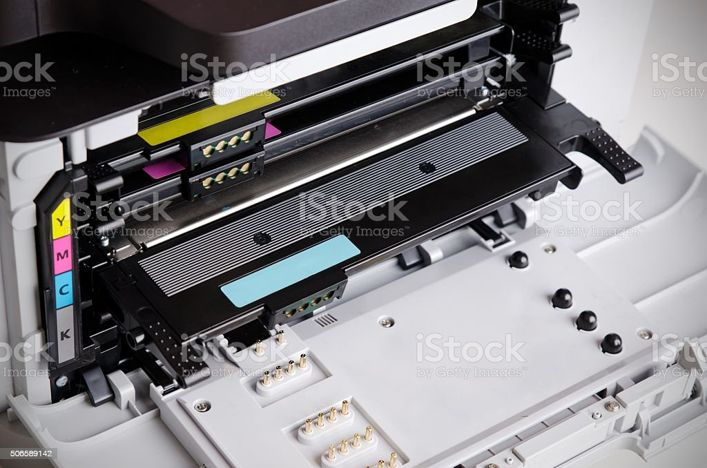 Close up of color laser printer toners cartridges stock photo