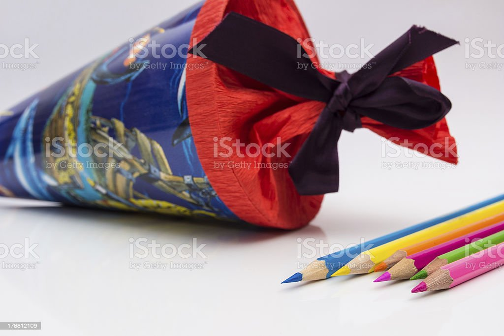 Close up of colored pencils and a school cone stock photo