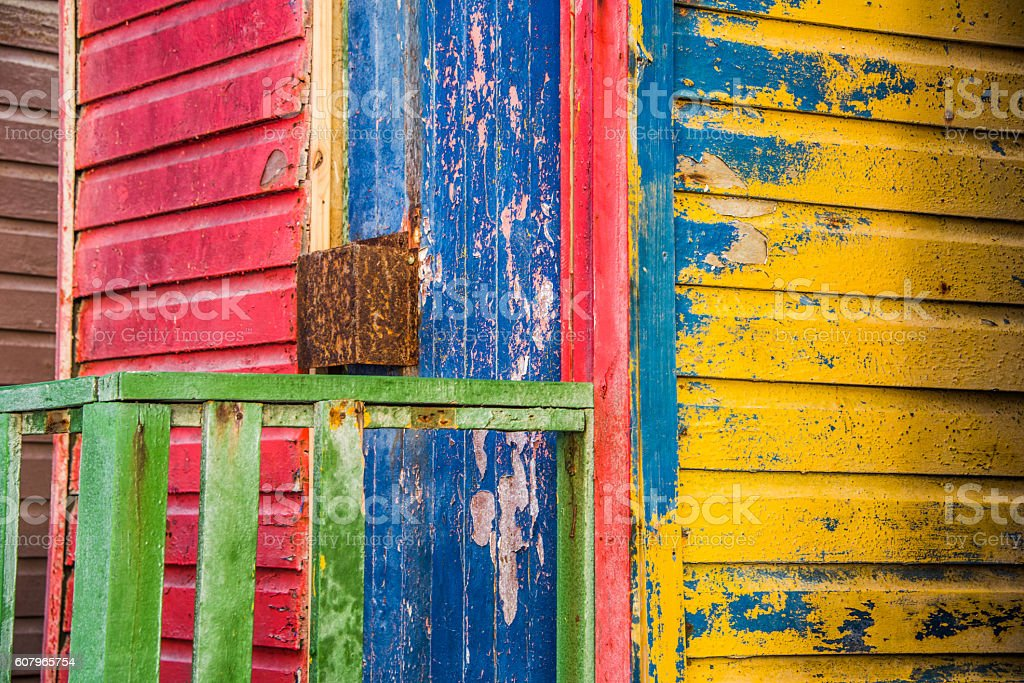 close up of colorful cabana with rustic painted wood stock photo