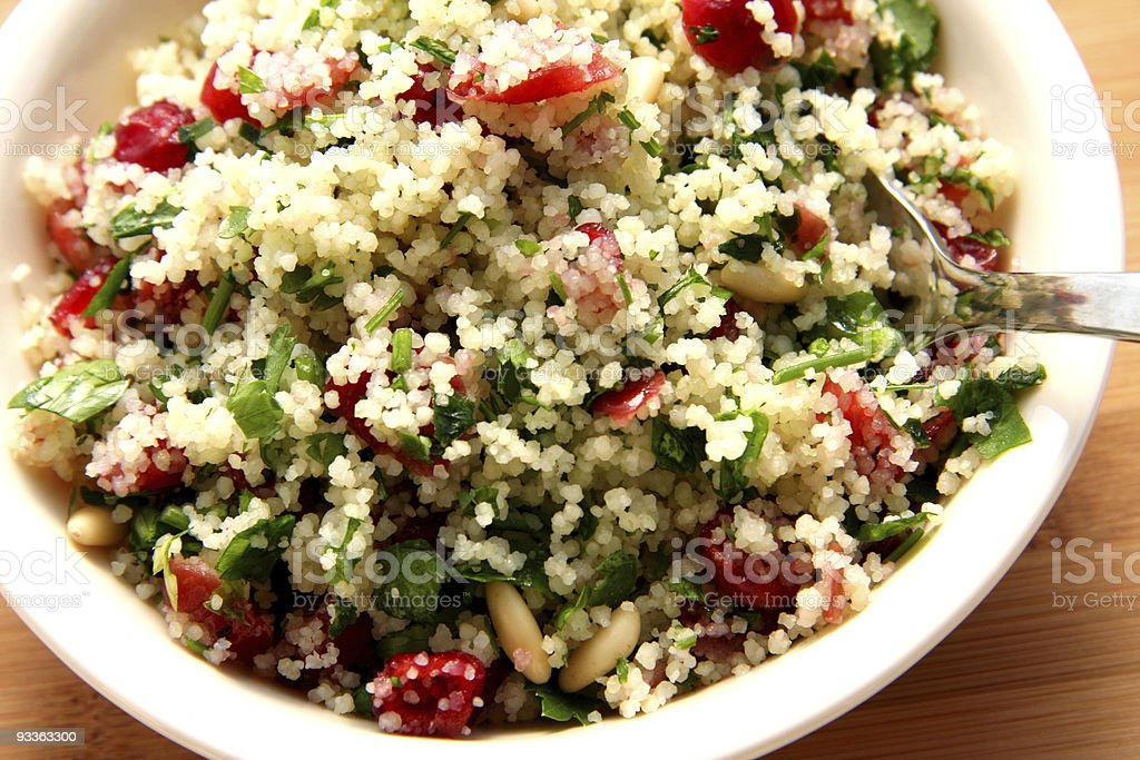 Close up of colorful couscous salad stock photo