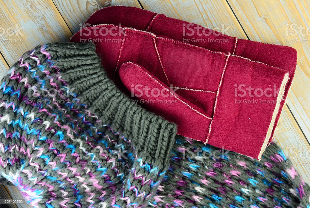 close up of colorful knitted hat, scarf and mittens gloves stock photo