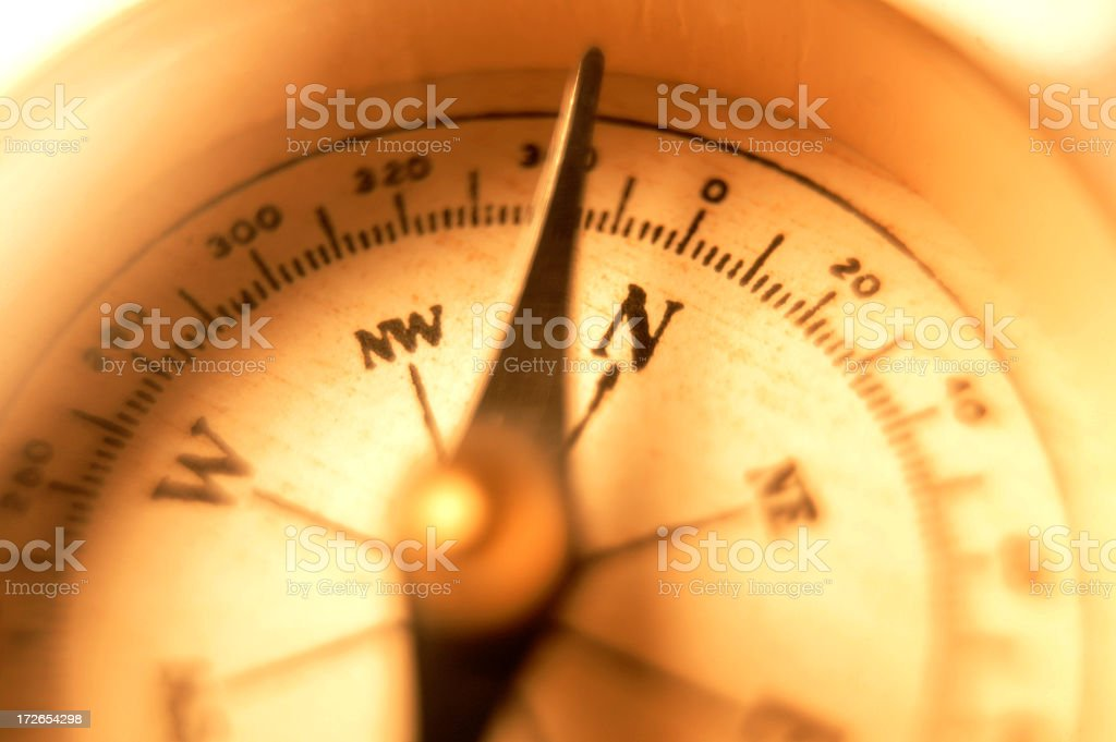 Close Up Of Compass face Warmly Lit royalty-free stock photo