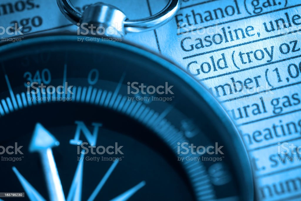 Close up Of Compass On A List Of Various Commodities stock photo