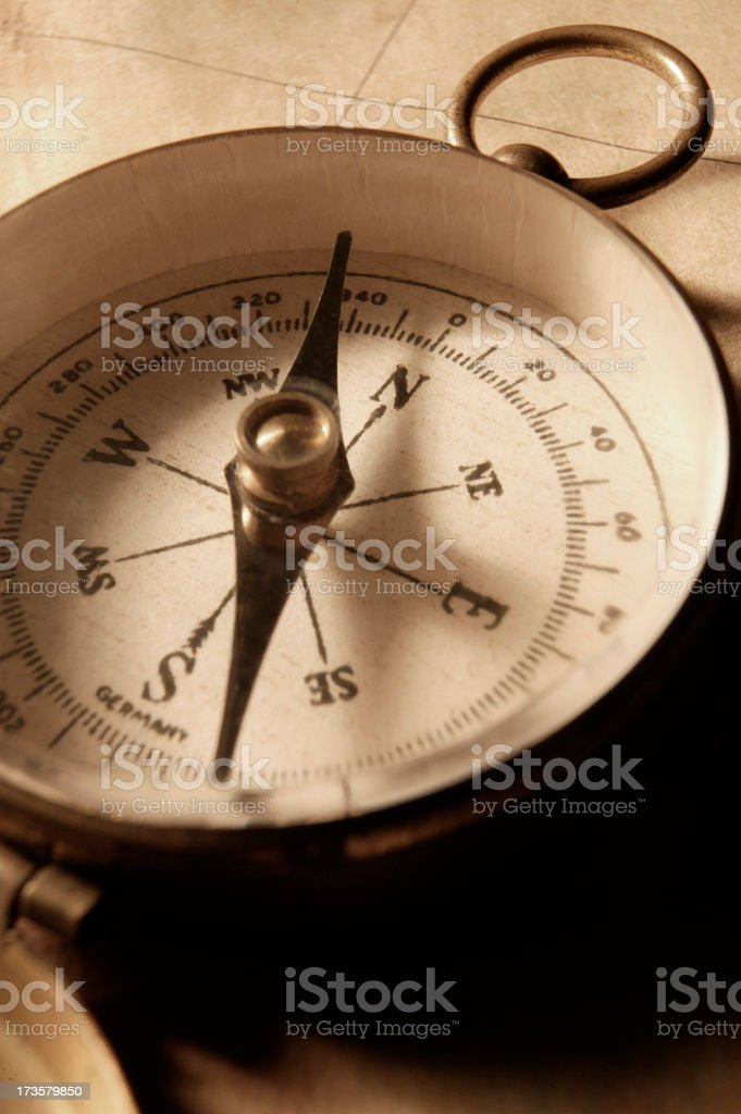 Close Up of Compass On Antique map royalty-free stock photo