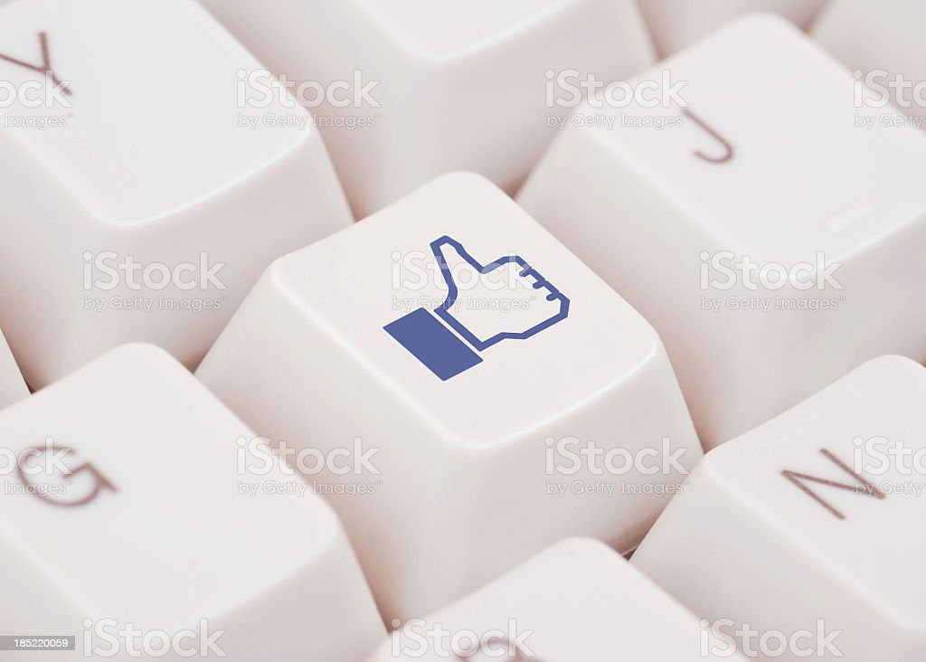 Close up of computer key with Facebook like logo royalty-free stock photo