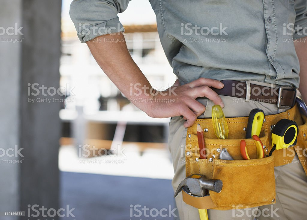 Close up of construction workers tool belt on construction site royalty-free stock photo