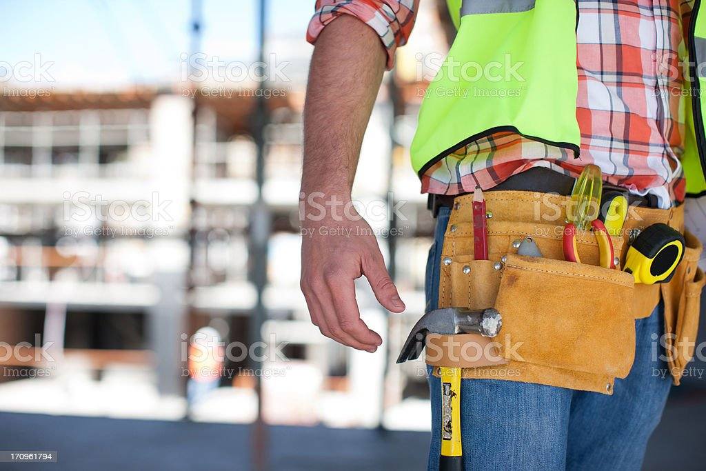 Close up of construction worker's tool belt on construction site stock photo