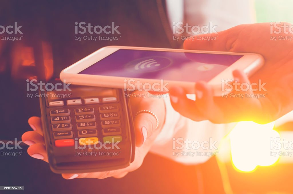 Close up of contactless pay with a mobile phone. stock photo