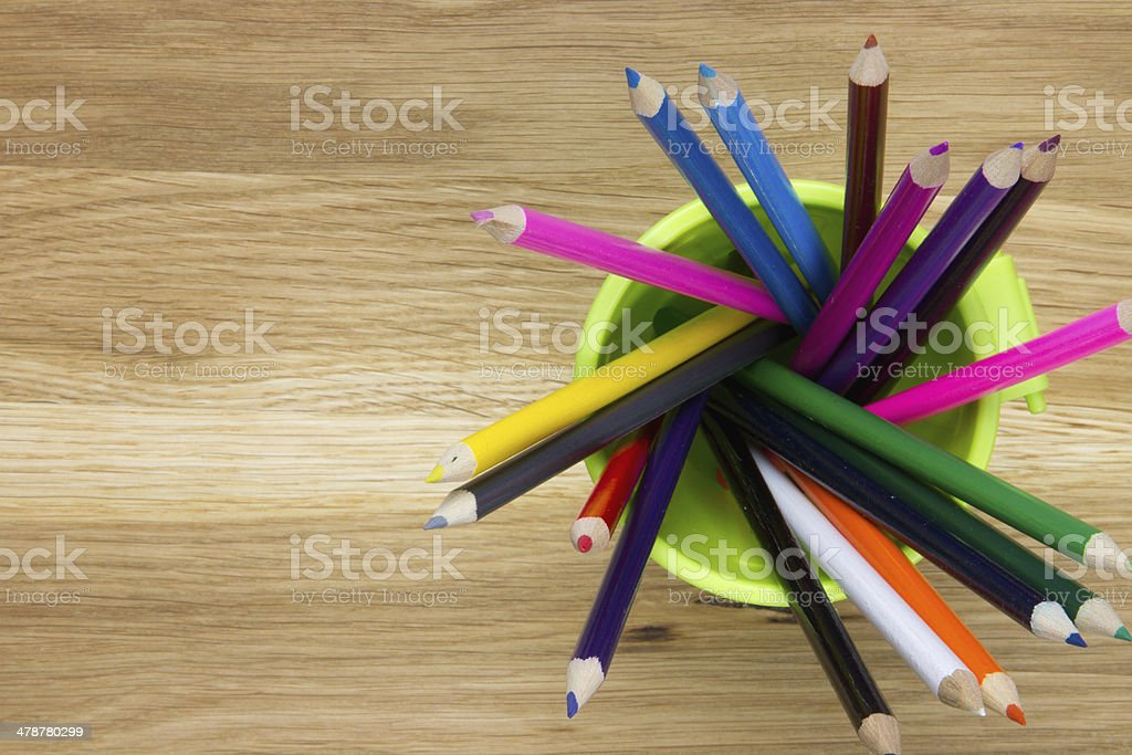 close up of container filled with coloring pencils stock photo
