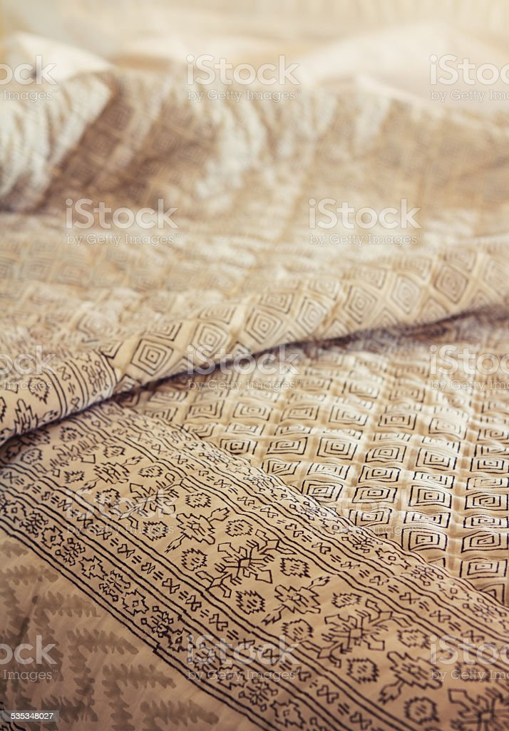 Close up of contemporary black and white bed quilt cover stock photo