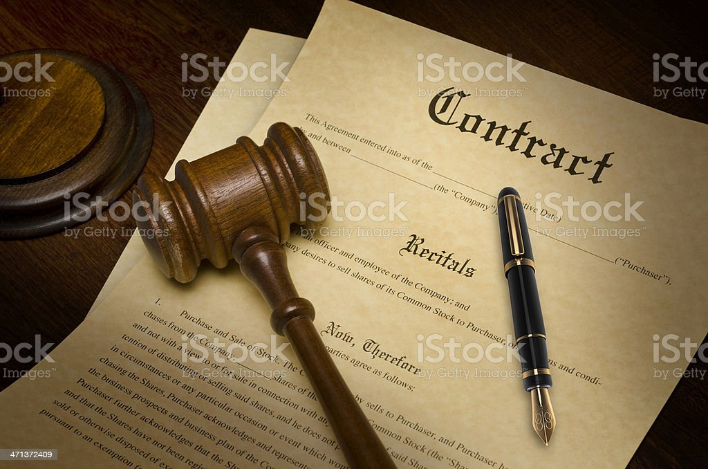 Close up of contract and pen with judges gavel stock photo