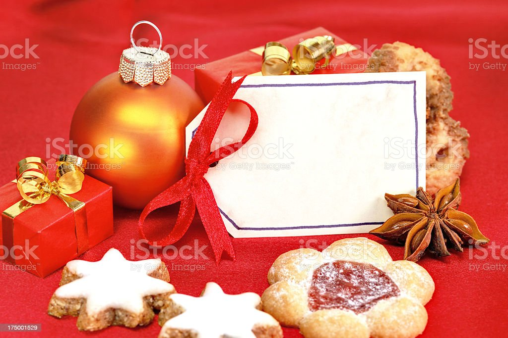 close up of cookies and greeting card for christmas stock photo