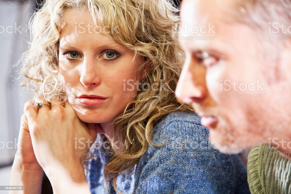 Close up of couple, focus on woman stock photo
