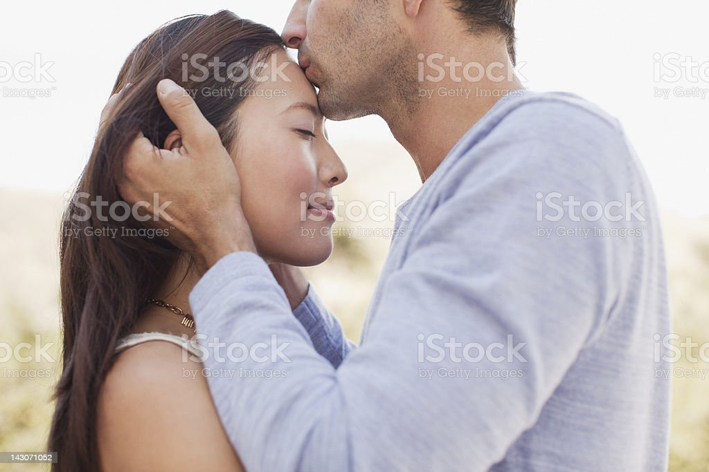 Close up of couple kissing stock photo
