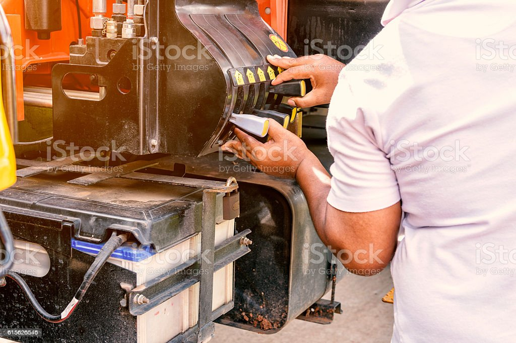 Close up of crane truck hydraulic control. Mechanical levers of stock photo