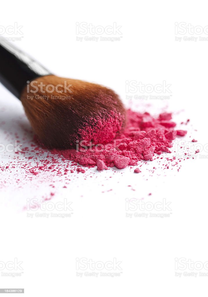 Close up of crushed cosmetic and brush stock photo