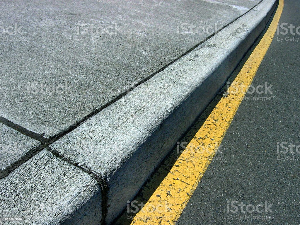 Close up of curb on a street stock photo