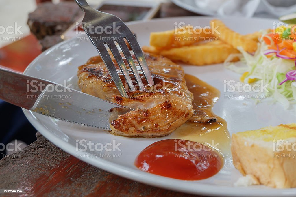 Close up of cut the chicken steak in dish. stock photo