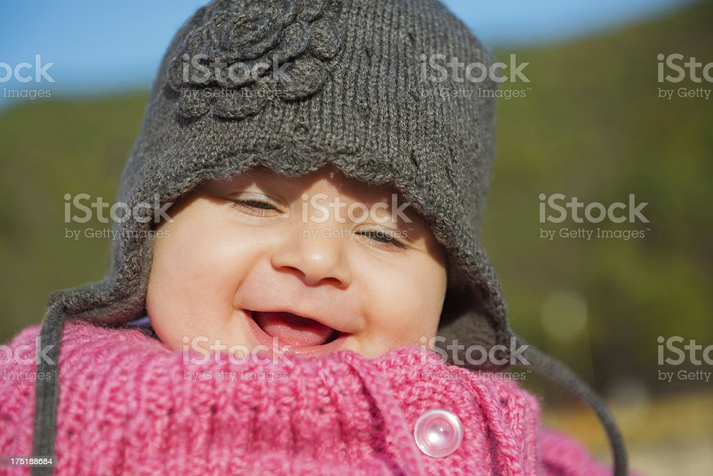 Close up of Cute Baby Smile Face Outdoors royalty-free stock photo