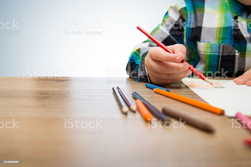 Close up of cute child with color crayons stock photo