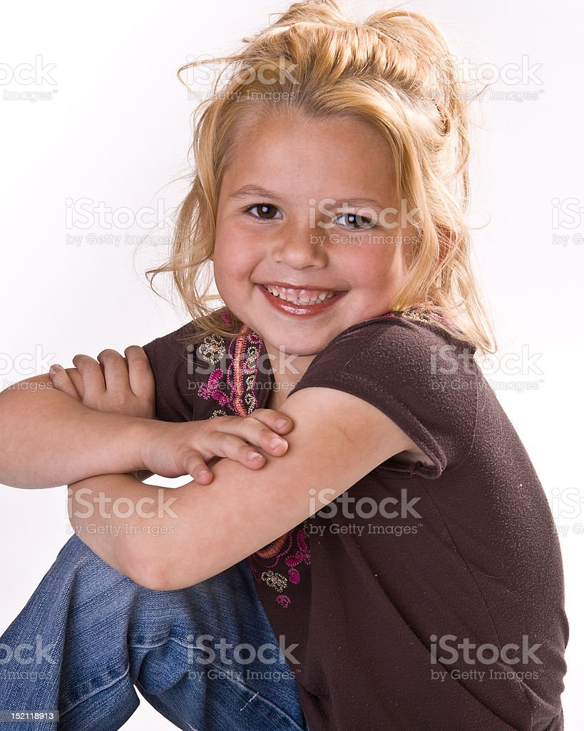 Close up of cute little girl with her arms crossed royalty-free stock photo